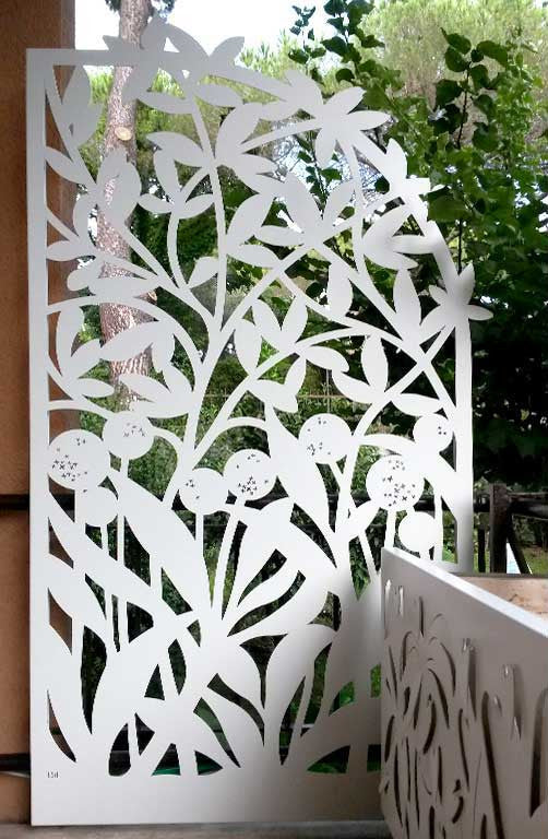 laser cut aluminum panels with a Forest design, enriched by high luminosity LED backlighting