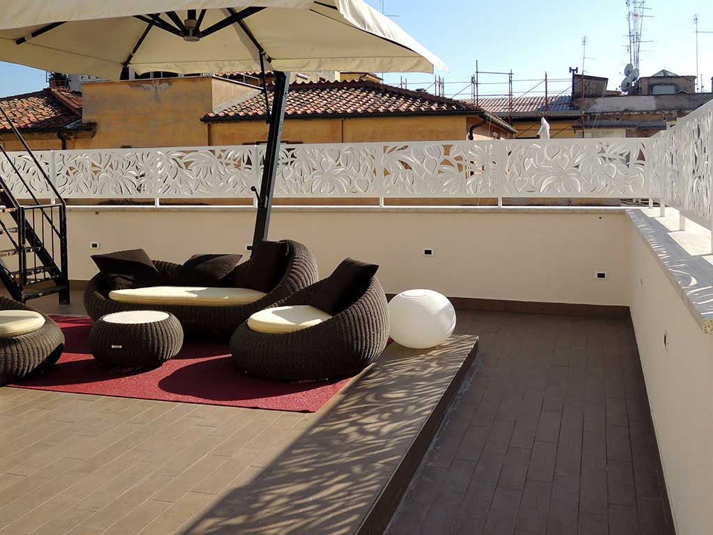 rooftop terrace of hotel Life in Rome; laser cut metal screens all around the terrace perimeter.