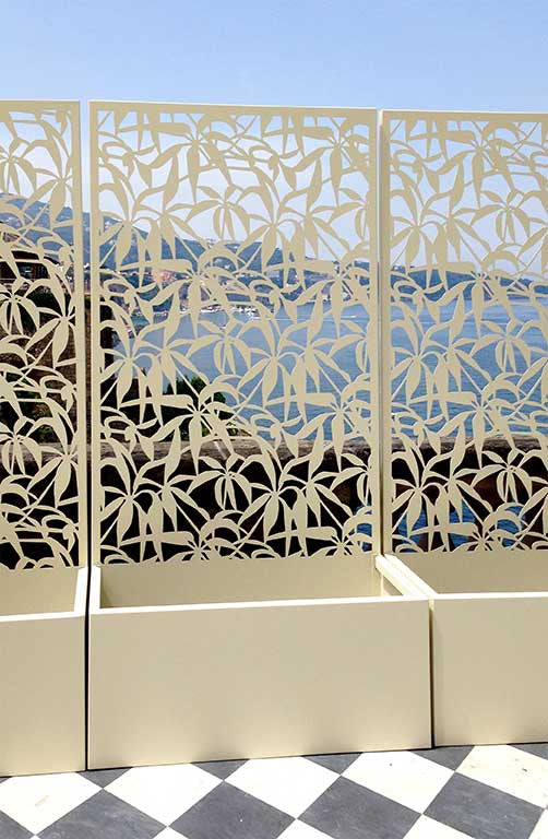 terrace overlooking the sea; laser cut aluminum screens with planters