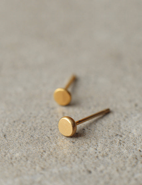 gold dot stud earrings by Studio Baladi