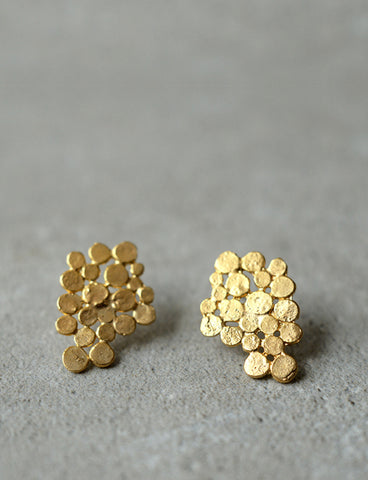 Gold cluster earrings by Studio Baladi