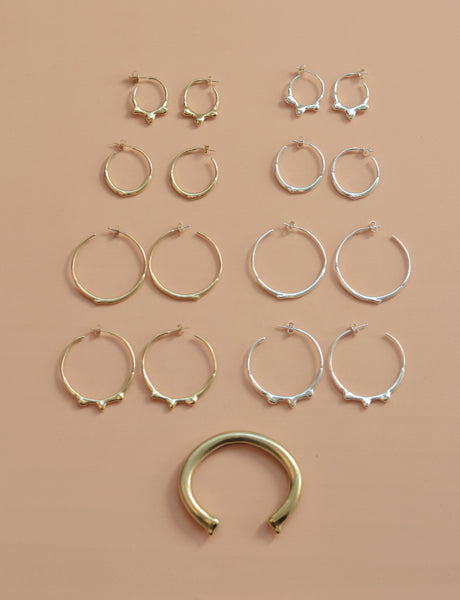 Drop hoop earrings by studio baladi