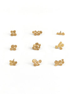Singles cluster earrings by studio baladi