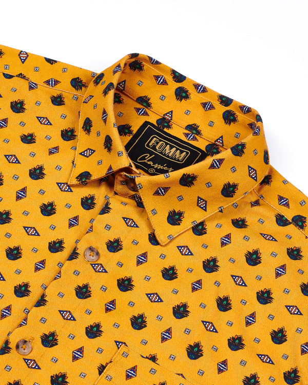 FOMM Men's shirt featuring floral geometric repetitions on a mustard yellow background.