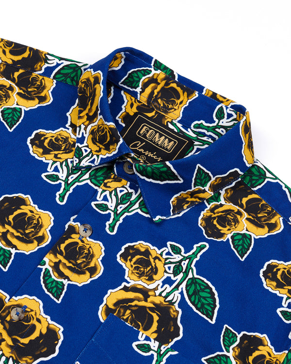 FOMM Men's shirt features mustard roses and green foliage sublimated by a crisp white outline.