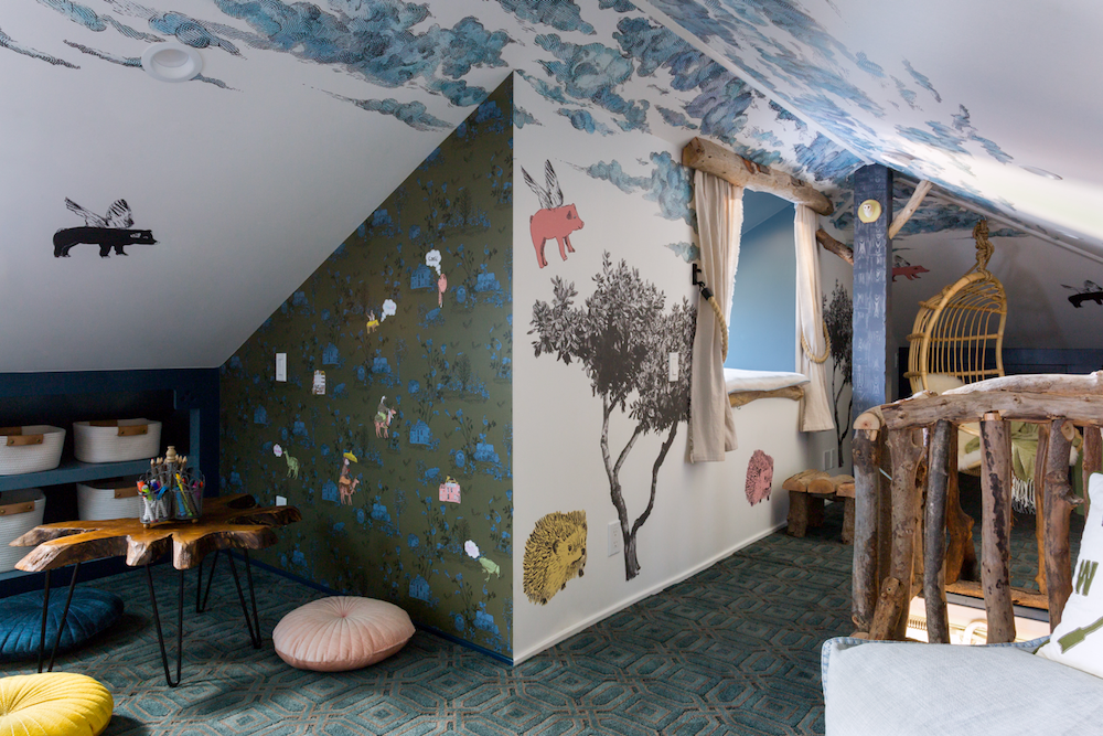 Attic play space with cloud ceiling, tree and animal wall stickers