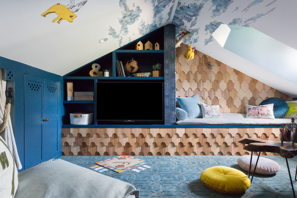 Attic space with cedar shingle tv wall and built in bench, cloud wallpaper, flying pigs, blue