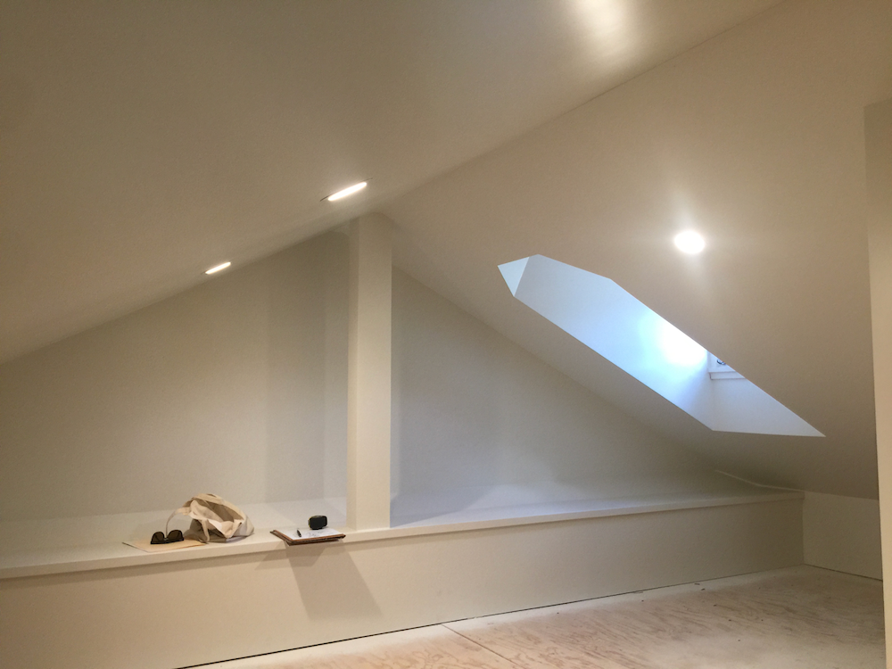 Unfinished white attic space