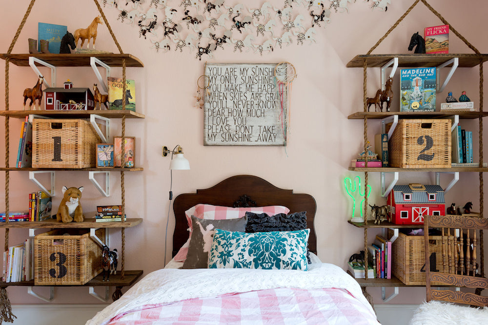 Pink Girl's Room with reclaimed barn wood rope shelving and baskets for toy storage