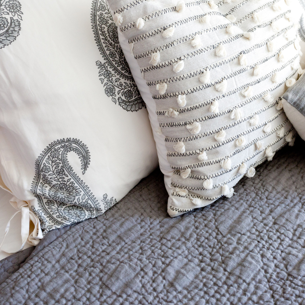Gray and white bed pillows