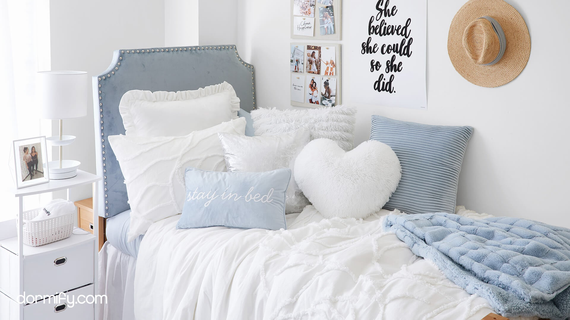 White and blue girls bedding with comforter set and pillows from Dormify