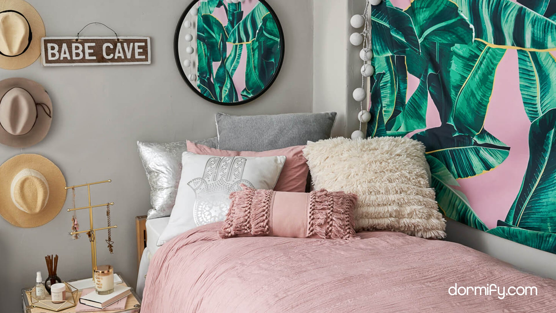 Beverly Hills Bedroom set by Dormify that includes a pink comforter, decorative pillows, and green leaf wall decor.