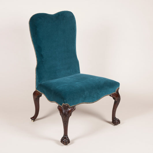A large 19th century upholstered side chair with a high shaped back in the George II style with carved cabriole legs.