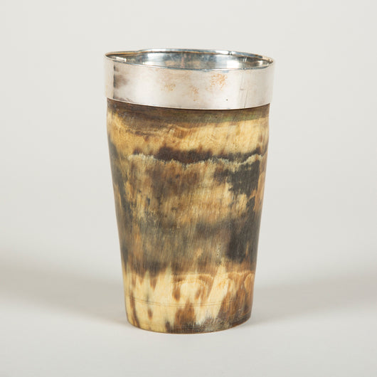 A 19th century horn beaker with a silver interior and rim.