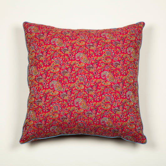 Cushions made up from a vintage woven fabric with a paisley pattern on a red ground, Jaipur. £625 each.