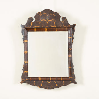 A small Queen Anne style oyster-veneered mirror with original plate in a crested and shaped frame. 19th century.