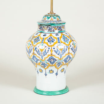 A polychrome decorated pottery baluster vase and cover, 20th century Moroccan, wired as a lamp.