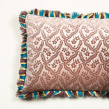 Cushions made up in a dusky mauve gaufragged velvet with a cut fringe to the edge, backed in blue silk. £410 each + vat.