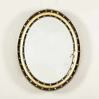 An early to mid-19th century Irish oval mirror the black and gilt channelled frame set with brilliants..