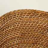 A charming low coiled wicker tub chair. 20th century, possibly Indian.