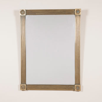 A fine quality early 19th century French mirror, the rectangular reeded frame with floral corner bosses and the original mercury glass plate.