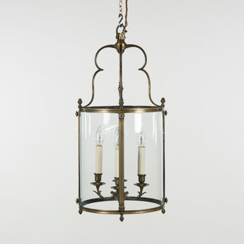 A large cylindrical brass lantern with elegantly curved supestructure, late 19th century.