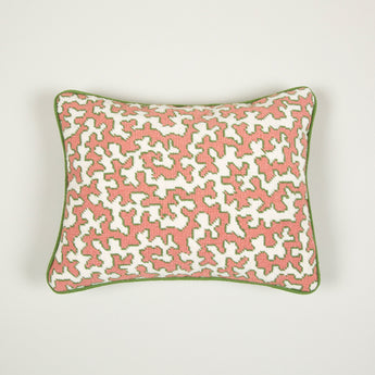 A needlepoint of the Squiggle design in apricot made up as a cushion.