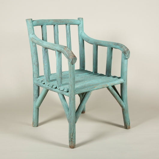 A pair of blue-painted garden or conservatory armchairs made of tree branches, French late 19th century.