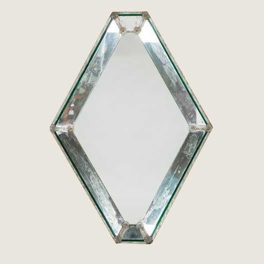 A small lozenge shaped murano mirror, circa 1950's. With a segmented mirrored border.