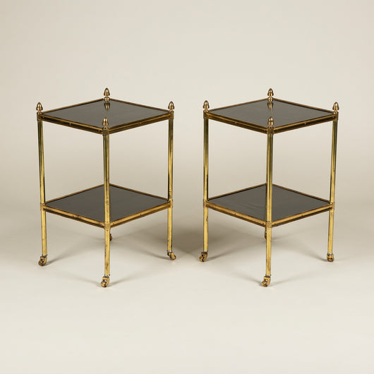 A pair of square, two-tier brass-framed and ebonised wood tables. Early 20th century. £2,400.00 each.