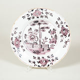 A set of five 18th century Dutch Delft plates with manganese floral decoration.