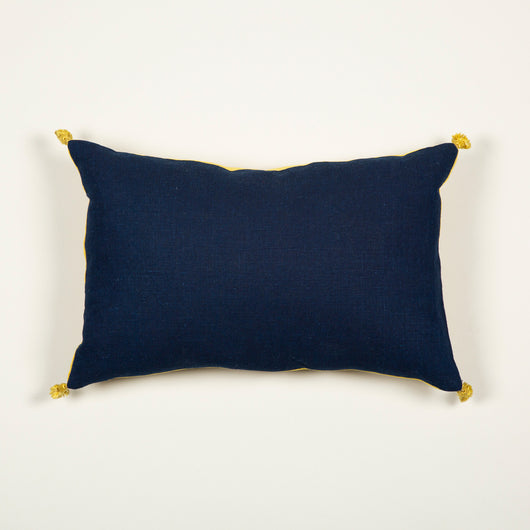 A cushion made up from 20th century indigo dyed linen backed with bourette finished with silk tassels.