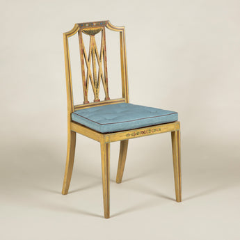 Four late 19th century painted beech side chairs with caned seats. Original painted decoration restored in parts.