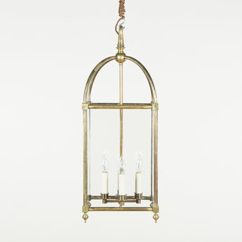 A 19th century Swiss square brass hanging lantern with a domed cage top, wired for electricity.