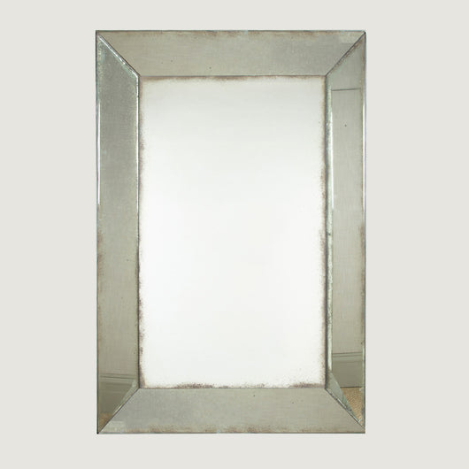 A rectangular Italian mirror with a mercury glass plate and mercury glass wedge-shaped frame. Mid-20th century.