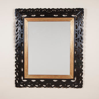 A 19th century Italian rectangular mirror with a reeded giltwood inner frame and ebonised walnut open fretted outer frame.