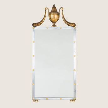 A steel and gilt brass rectangular mirror with urn and swag crest. Maison Jansen, mid-20th century.