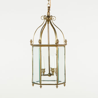 An 18th century style hexagonal brass hall lantern with bevelled glass panels. Early 20th century.