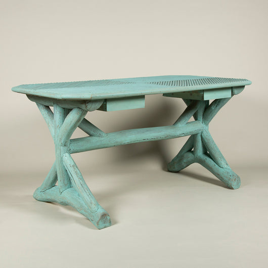 A blue-painted garden or conservatory table, the rectangular top with canted corners and two small drawers underneath, the legs and stretchers made from tree branches. French, late 19th century, the drawers probably later.