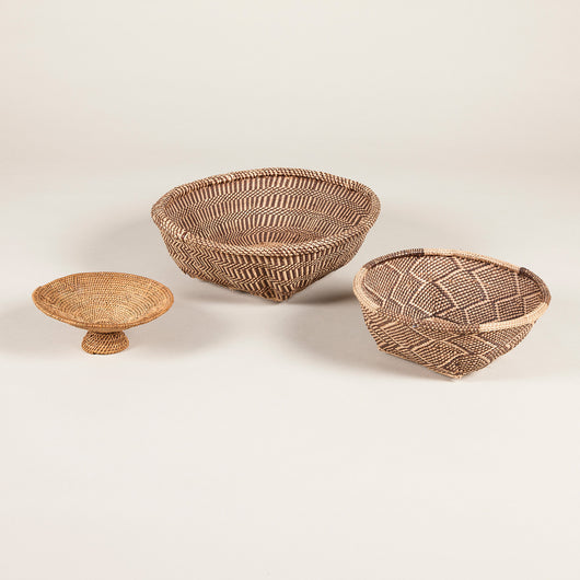 A set of three Rhodesian baskets of graduating size, 20th century. £80 each.