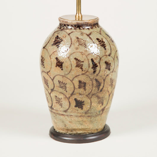 An 18th century Persian vase with simple all-over underglaze decoration in brown on a grey/green ground, wired as a lamp.