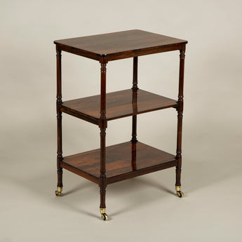 A mid-19th century rectangular rosewood veneered etagere on brass castors. Circa 1840-1860.