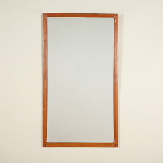 A rectangular teak-framed mirror by Aksel Skjergaard with stop-chamfered inner edge and exposed dowel corner joints. Danish, circa 1960. Stamped on the back.