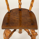 A pair of small rustic chairs made from twisted vine wood. 19th or early 20th C. Probably French. (matched pair)