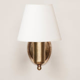 Fixed arm wall light with oval back plate. Made to order. Other finishes cab be quoted for. Price includes card shade.