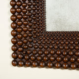 Two square mirrors with wide flat teak frames carved with concentric graduated borders of balls.