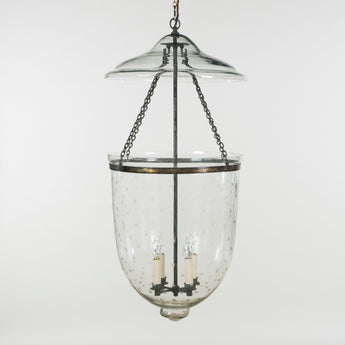 A pair of large glass bell hanging lights with etched star decoration, Rajasthan, India.