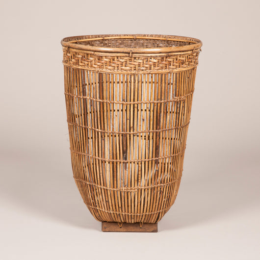 A pair of tall cane baskets with square wood bases, oriental 20th century. £345 each.