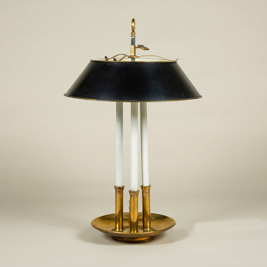 A large brass three candle bouillotte lamp with a black tole shade. French, 20th century.