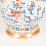 A late 18th or early 19th century Chinese octagonal vase decorated with scenes in the Imari palette, wired as a lamp.